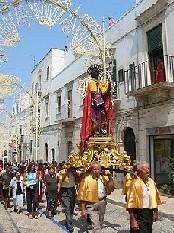 Foto della statua di San Rocco durante la processione